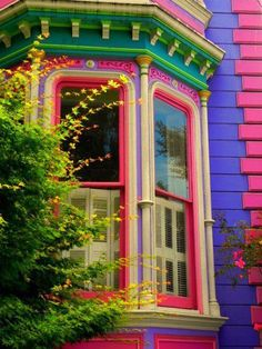 Childhood peace and Gingerbread Houses come to mind when seeing the lovely pastel colors of this old house's alcove of windows - violet purple, pink, green yellow... and a lovely early spring tree in front. -DdO:) - http://www.pinterest.com/DianaDeeOsborne/intriguing-architecture/ - Some Russian architecture uses this color palette design also.