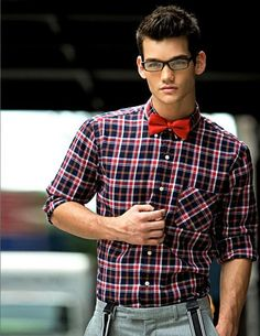 Rule of thumb: Wear contrasting patterns. For example, solid ties work well with patterned shirts, as in this example. The red of the bow tie brings out the accent color in the shirt.