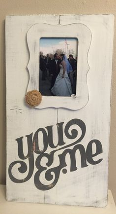 Hand painted Distressed White/Gray You and Me Sign with 4x6 Picture frame attached. Approx Size 11x20 Asking $25 The back is unfinished and ready to