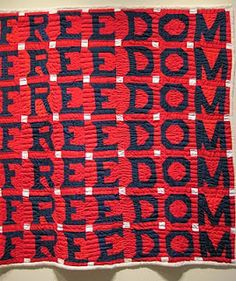 African American quilt. The story behind this quilt: the maker was fired from her job for exercising her newly-gained right to vote, and as a way to work through her emotions, stitched a series of FREEDOM quilts.  She made this one in the 1980s.