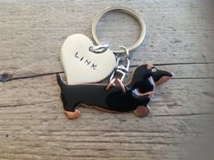Black and Tan Dachshund Keychain Doxie by tagsoup on Etsy. Love this! They also have a red dachshund and they can make your keychain with 1,2,3 or 4 dachshunds.