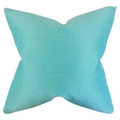 """Add a pop of color to your settee or favorite arm chair with this cotton pillow, showcasing a charming aquamarine hue.   Product: PillowConstruction Material: Cotton cover and 5/95 down-feather fillColor: AquamarineFeatures:  Hidden zipper closureMade in the USAInsert includedDimensions: 18"""" x 18""""Cleaning and Care: Spot clean"""