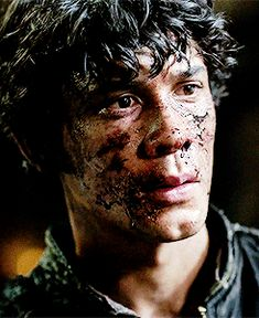 THE WAY HE STARES AT CLARKE.
