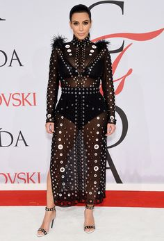 Kim's baby bump made its red carpet debut at the CFDA Awards in a sheer Proenza Schouler number.