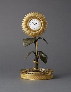 A unusual Empire Sunflower Clock. France, first quarter of the century offered by Viebahn Fine Arts. Wall Clock Brands, Wall Clock Online, Antique Mantel Clocks, French Clock, Classic Clocks, Retro Clock, Cool Clocks, Wall Clock Design, Instruments