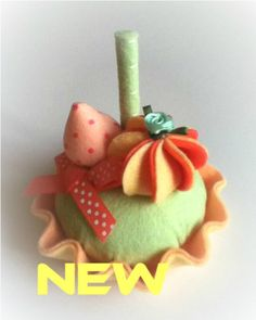 LOVELY SPRING pincushion felt food cake toy. $8.00, via Etsy.