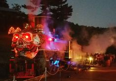 The Ghost Train looked ominous against the darkening mountain sky as passengers waited to board.