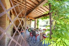 The interior and exterior of the apartment Girasole in the Canale Farm, Montelopio, Tuscany.