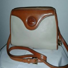 DOONEY & BOURKE VINTAGE HANDBAG Leather vintage bag with adjustable shoulder strap, 2 inside zipper pockets, 2 small inside compartments, 1 large inside compartment. Pre worn but it's in very good condition. Dooney & Bourke Bags