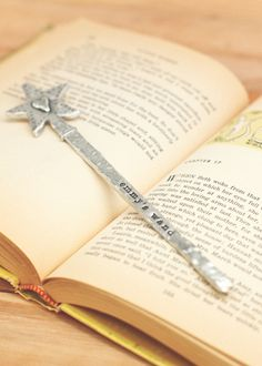 pewter wand- I cannot even tell you how badly I want this.  Considering my college advisor at Marian handed me a wand after I got my diploma it would be fitting to get one now with my Masters completed.... $32.00