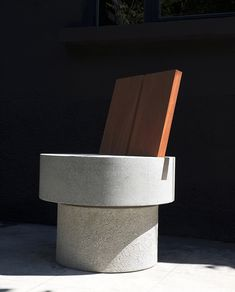 andrea tognon shapes iroko concrete chair with bold, abstract gestures