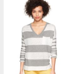 GAP striped v neck sweater Loose fitting, lightweight v-neck with pocket makes for a grey layering piece in this still mild weather. Dolman sleeve adds to the loose, casual feel. Like new! Check out last picture (blue sweater) for fit! GAP Sweaters V-Necks