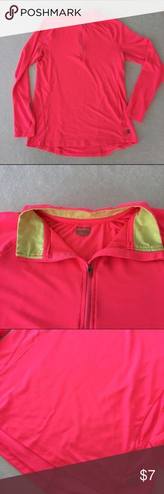 Hind running top You don't have to worry about being seen in this top. Stay highly visible with this hot pink top the featured thumb holes and 1/4 zip design. There are some picks on this shirt. Unfortunately it's the nature of the material but they aren't that noticeable it doesn't take away from this shirt. Hind Tops