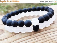 YINYANG Bracelet, Black and White Bracelets, Set Of Two Bracelets, Gemstones Matte Onyx White Snow Quartz Unisex Stretch Bracelets  Bead size: 8 mm  You can see more bracelets here: https://www.etsy.com/shop/BohemianChicbead  Keywords: Power, Energy, Clarity  Quartz i is the most recognized type of crystal. In fact, many people envision quartz crystals when they think of crystals, even though there are many different types of crystals. Quartz can be icy clear or have inclusions, veils…