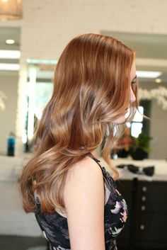 Side // Hints of blonde, brunette and auburn. Long sides, almost not there layering, side bangs.