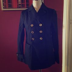 Military style navy pea coat xs-s  Banana Republic - Navy blue military pea coat with brass buttons. Worn a few times. Inside has a red lining. Light weight, excellent for cool days or with layer.    Size says xs but would fit a 0-4                                                                             - Ships the same day.  Banana Republic Jackets & Coats Pea Coats