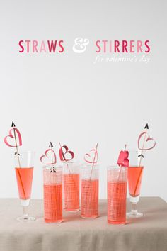 Valentine's Day party - swooning over the hearts threaded onto the straws!!