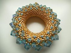 Yet another example of Petra Tismer's wonderful Golden Sun pendants
