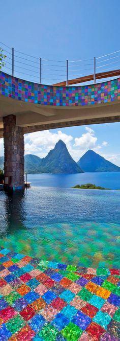 Jade Mountain with the Pitons in the background on St. Lucia. Great honeymoon destination! ASPEN CREEK TRAVEL - karen@aspencreektravel.com