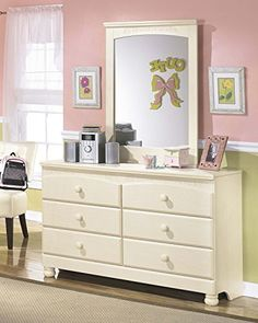 "The ""Cottage Retreat"" youth bedroom collection takes early American country design to create a fun and inviting cottage retreat perfect for any child's bedroom. The replicated light cream paint with subtle replicated brushing flows over the graphic leaf d Wood Dresser, Dresser With Mirror, Dresser As Nightstand, Double Dresser, Bedroom Dressers, Bedroom Furniture, Mirror Bedroom, Twin Bedroom Sets, Ashley Bedroom"