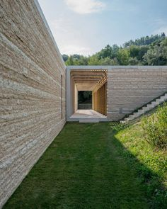 Locally quarried stone is used in a simple, modern way in conjunction with wooden pergolas and window frames at this Italian villa. By David Chipperfield.