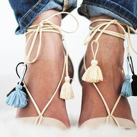 An easy and versatile way to turn your regular strappy sandals into trendy lace-up ones finished with fun tassel details.