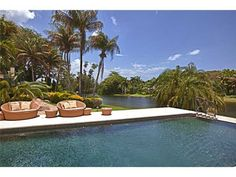Infinity pool leading out to the view of the water is beautiful!  10801 Snapper Creek Rd, Miami FL
