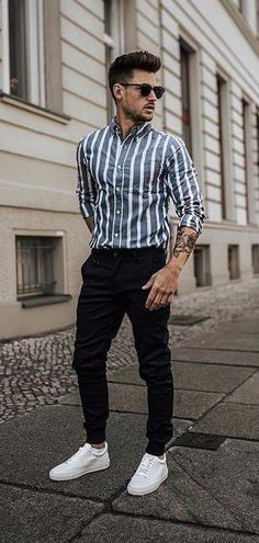 - with a summer outfit idea with a blue white striped button up shirt with rolled up sleeves sunglasses black denim white sneakers Summer Outfits Men, Stylish Mens Outfits, Casual Outfits, Men Casual, Spring Outfits, Men's Summer Clothes, Tucked In Shirt Outfit, Outfit Jeans, Formal Men Outfit