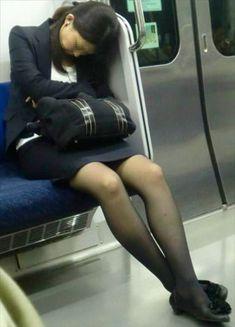 Mature lady wearing pantyhose on a train