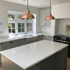 This traditional style kitchen is simply outstanding. With the love for clean lines and vintage colours it makes it the perfect space for the hub of the home. It features our Carrera style quartz. So much worktop space is available in this kitchen. Stainless Steel Taps, Composite Sinks, Industrial Style Kitchen, Glass Sink, Copper Lighting, Cottage Kitchens, Basin Sink, Minimalist Kitchen, Traditional Kitchen