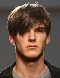 Short Model for Classic Cut with Long and Wispy Softening Bangs
