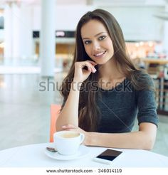 woman drinking coffee in the morning at restaurant soft focus. Smiling pretty girl with cup of tea. Cheerful lady enjoy and relax