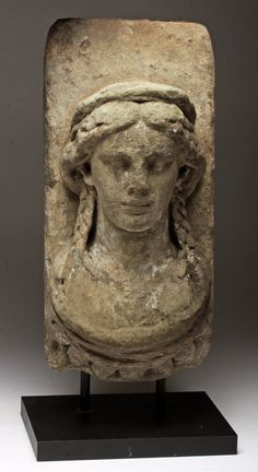 A ROMAN LIMESTONE BUST OF A YOUNG WOMAN.  Britain, Roman Empire, ca. 2nd - 5th century CE