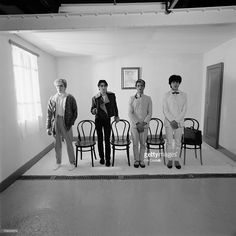 English band Japan posed standing by chairs with a portrait of Chairman Mao behind during the Tin Drum sessions in London in September 1981. L-R: David Sylvian, Steve Jansen, Mick Karn, Richard Barbieri.