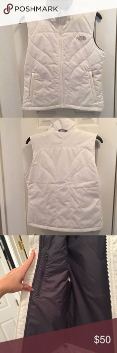 The North Face women's white and gray vest The North Face women's white and gray vest size medium. Like new white vest, worn once. I love this vest but I am just not a vest person...I need sleeves. :-)  Vest is white with a very light pattern in the background as seen in the last photo. Two outside zippered hand pockets and one zipper pocket inside. The North Face Jackets & Coats Vests