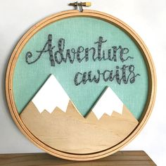 This adventure awaits embroidery hoop would be the perfect addition to any nursery or childrens playroom. The hoop is hand embroidered and has a woodland Scandinavian scandi feel to it. Why not gift it to a mum to be as a baby shower gift or a new baby gift. This 3D wooden mountain hoop art is ready to hang on a wall. I include a coordinating ribbon and/or bakers twine, that you can use to hang it with. It can also sit pretty on a shelf or look stunning in a wall display of other pictur...