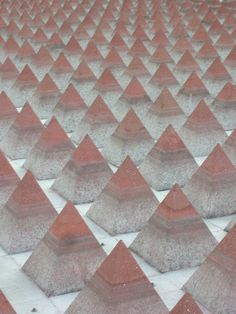 Mini Pyramids in Plaza Juarez, Mexico City    A public art display in the courtyard of a government building in Mexico City, Mexico.    Plaza Juarez, Mexico City, artist is Vicente Rojos