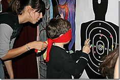 pin the bullseye on the body spy party game...too little for this, but cute