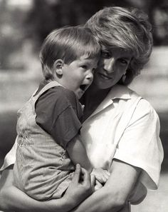 Young Prince Harry, yawns as his mother Princess Diana holds him during a morning picture session at Marivent Palace, August where the Prince and Princess of Wales are holidaying as guests of King Juan Carlos and Queen Sofia.