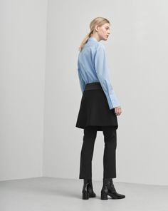 A mini overlap skirt with a asymmetric waist and bottom edge. Fold and tie details at front, with contrast satin details. Wool cashmere light melton. Wear on its own or style over pants. <br> <br> - Miniskirt style <br> - Overlap front <br> - Fold and