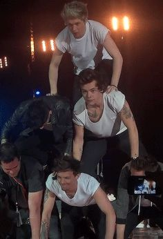 "Lol I just love this.  Louis looks like he's in pain but is pulling through anyway,  zayns just like ""yeah man!""  Harry's like ""just gonna smile through this"", then  Liam's making sure louis can handle it and is ok (like the daddy directioner he is),  then niall is just looks so excited at the top prolly saying ""this is great!"" Lol  and then the extra guy is laughing asking what he just got himself into."