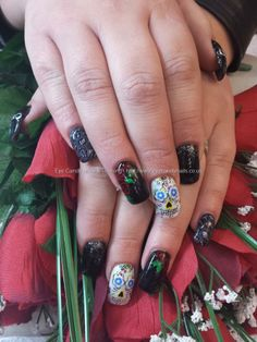 Black and white gel with leopard, roses, studs and  freehand sugar skull nail art