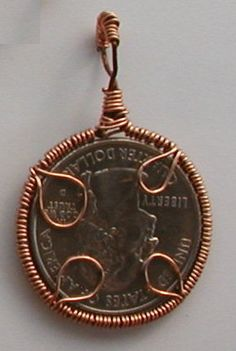 Wire wrapped jewelry items for sale...........good easy way to wrap coins and flat pieces