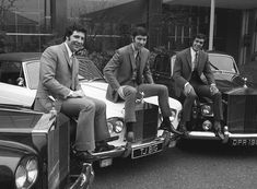 Music manager Gordon Mills, centre, and two of his singers Tom Jones, left and Engelbert Humperdinck sit on the bonnets of their Rolls Royce Silver Shadow cars. 1969