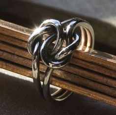 Celtic love knot ring: this could replace the Celtic tattoo I always wanted