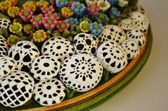 Doily covered river stones... Megann needs to learn how to do this. So she can do something with all her rocks.
