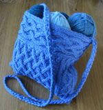 Quinn, a cabled bag.  This is what I will be starting tomorrow with Galway in a nice deep purple!