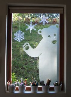 Christmas window made with self adhesive frosted vinyl. Looks good from both inside and out.