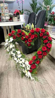 Trauergesteck Herz, rote Rosen,Calla und weiße Federn Funeral heart, red roses, calla and white feathers Funeral Floral Arrangements, Beautiful Flower Arrangements, Beautiful Flowers, Beautiful Pictures, Funeral Bouquet, Funeral Flowers, Funeral Sprays, Grave Decorations, Funeral Tributes