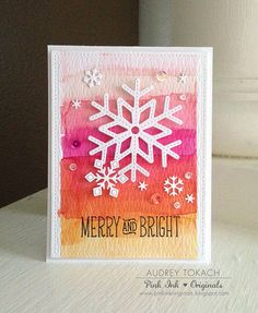 Lawn Fawn Stitched Snowflakes  & Mini Snowflakes dies; Lawn Fawn Snow Day stamp set (sentiment).  Watercolored background.  Inks:  Distress Inks Spun Sugar, Worn Lipstick, Picked Raspberry, Abandoned Coral, Spiced Marmalade